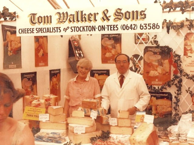 Pauline Chapman and Tom Walker at a cheese stall in December 1982