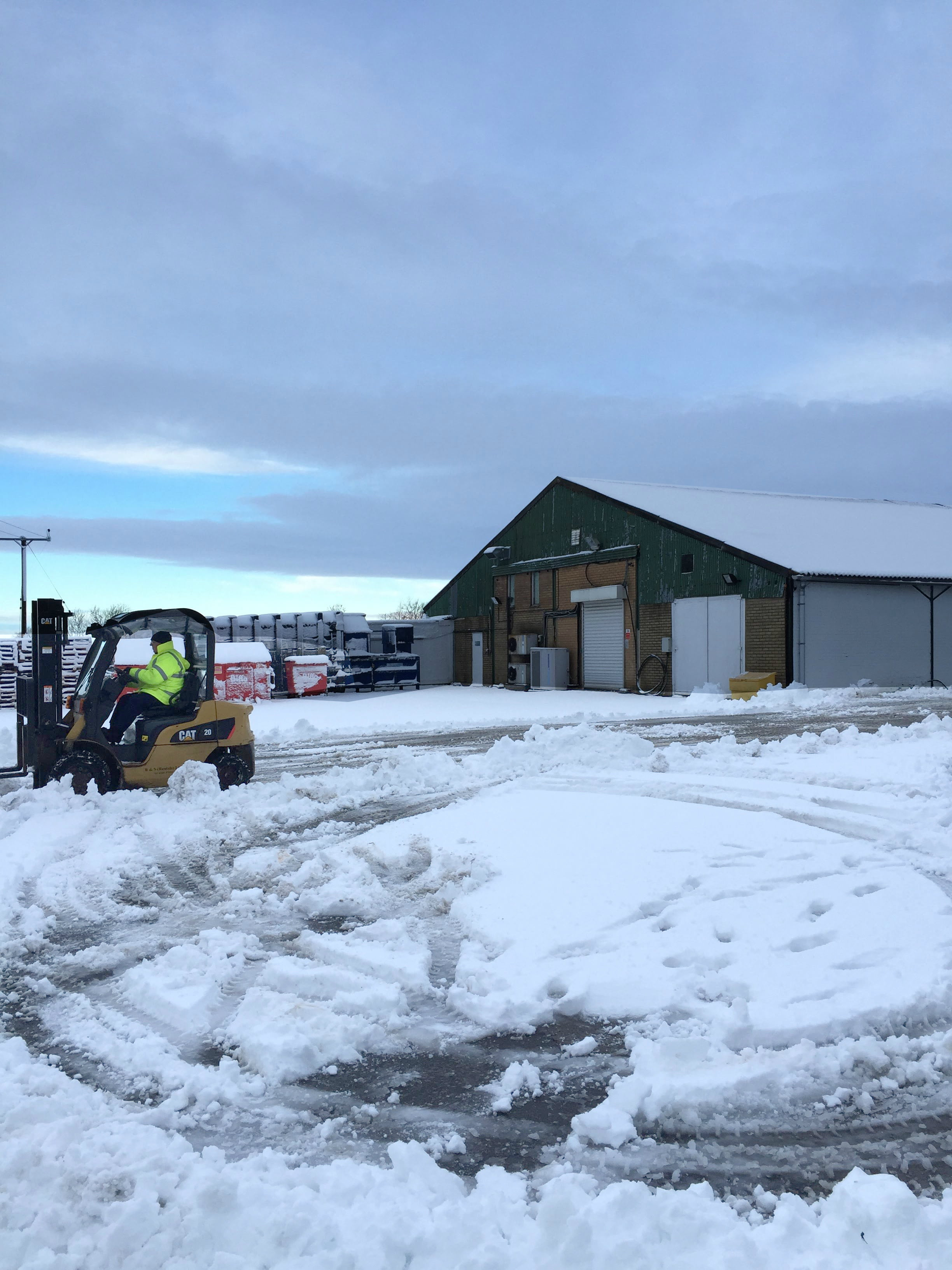 The snow plough at work in the yard