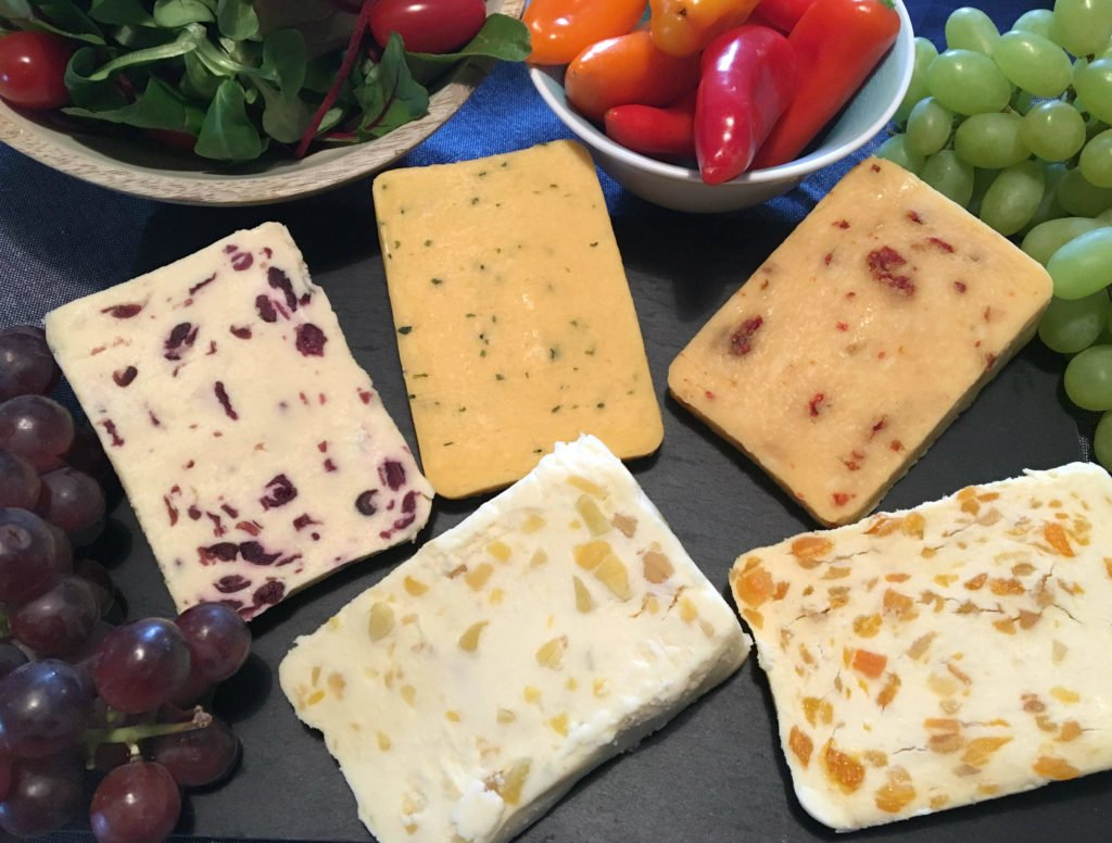 A board full of Blended Cheeses: Wensleydale with Cranberry, Wensleydale with Ginger, Wensleydale with Apricot, Mexicana and Double Gloucester with Chive and Onion.